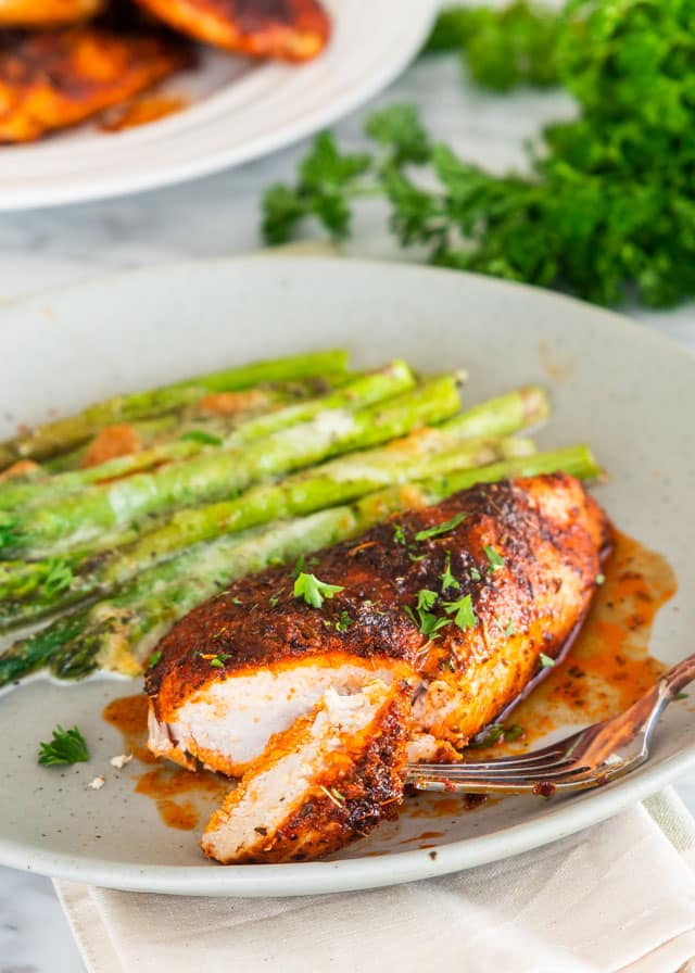 Baked Chicken Breast served with asparagus