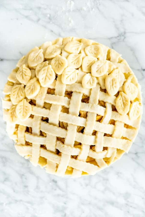 overhead shot of an unbaked pie topped with a decorative pie crust