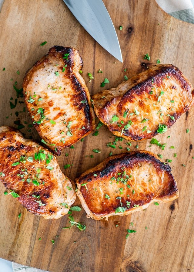 Pan Seared Pork Chops on a cutting board