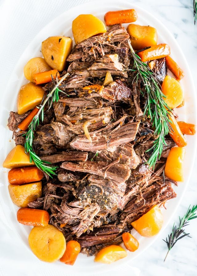 Crock Pot Roast on a platter with potatoes and carrots