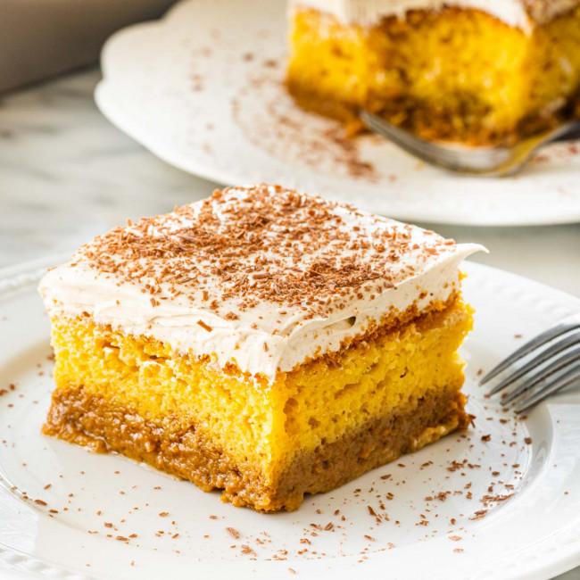 a slice of pumpkin magic cake on a white plate.