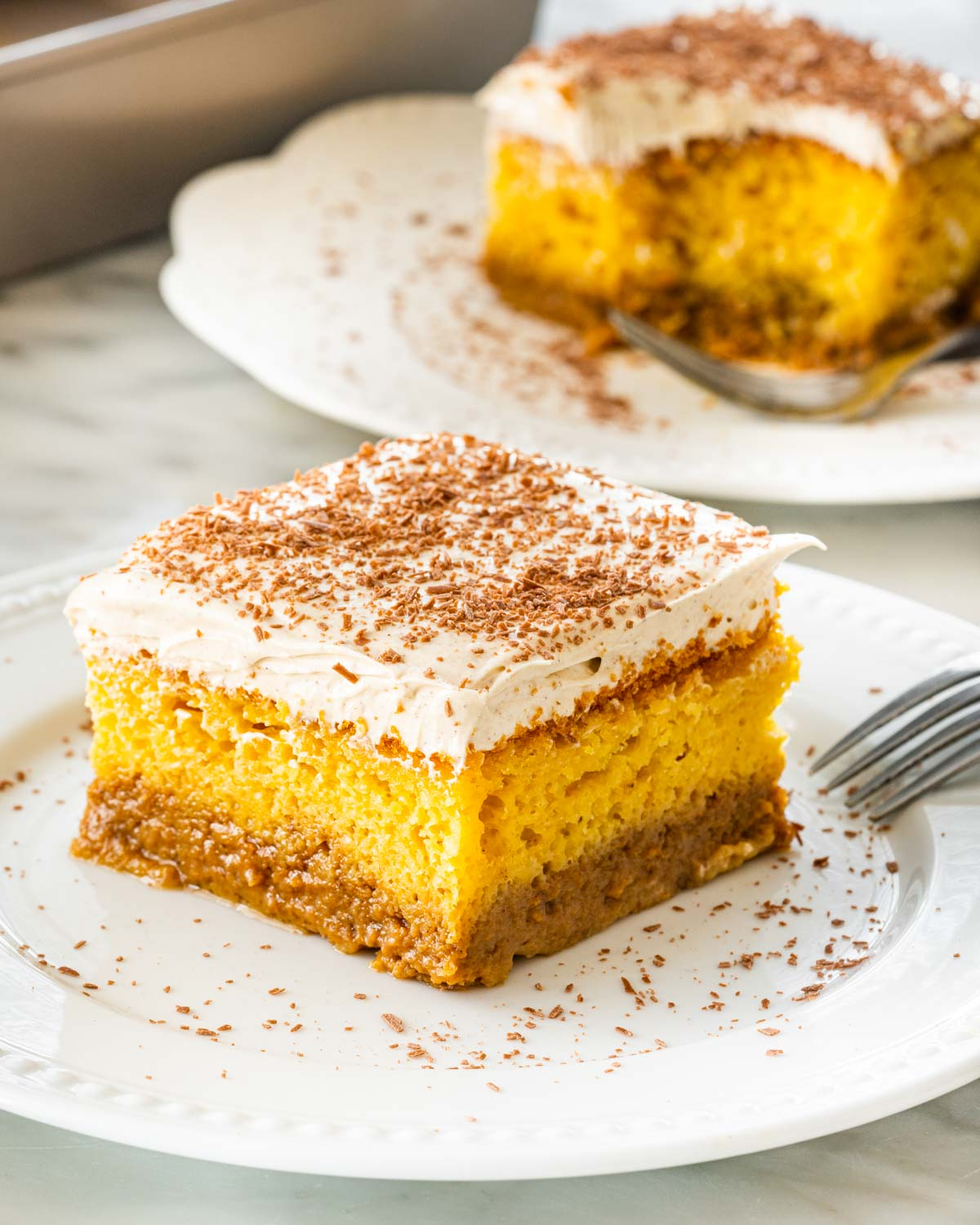 a slice of pumpkin magic cake on a white plate.