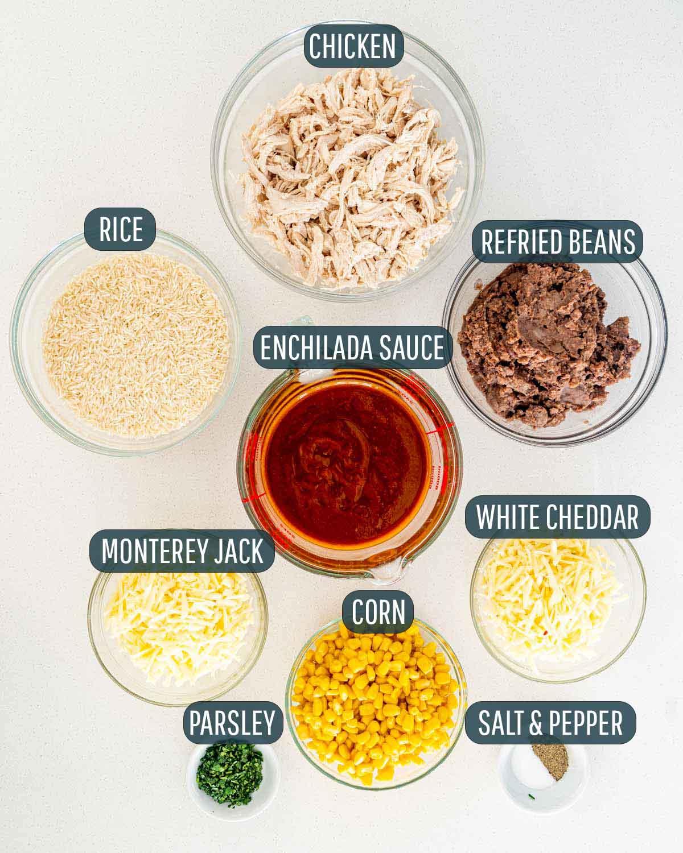 overhead shot of ingredients needed to make chicken enchilada rice casserole.