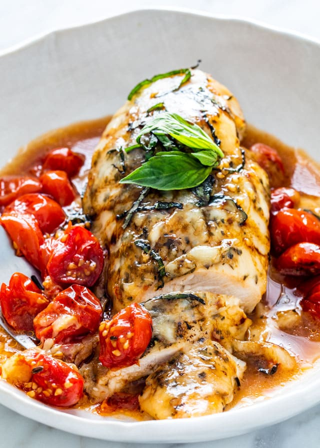 Caprese Chicken breast in a white plate