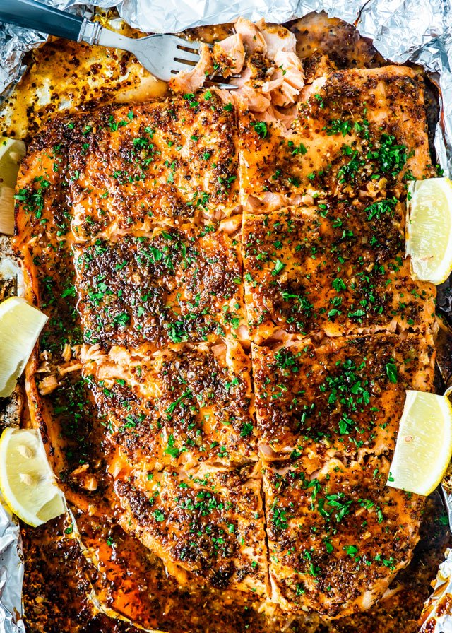 Honey Mustard Salmon in foil with lemon wedges