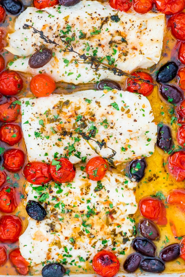 Lemon Butter Baked Cod with tomatoes and olives in a white baking dish