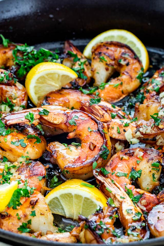 Honey Garlic Shrimp in a skillet with lemons