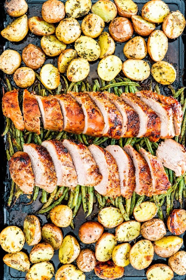 Honey Mustard Pork Tenderloin with roasted potatoes and green beans on a baking sheet