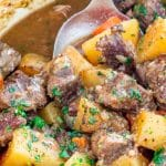 side view shot of a serving spoon taking a scoop of irish lamb stew