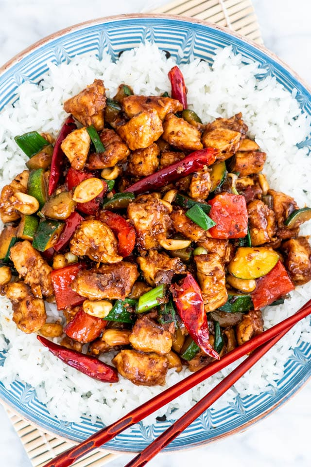 overhead shot of kung pao chicken over a bed of rice