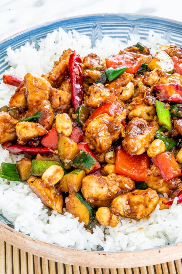 kung pao chicken over a bed of rice