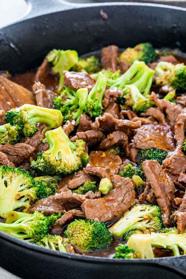 side shot of beef and broccoli in a skillet