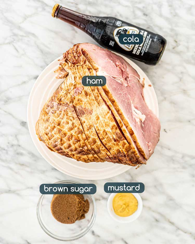 overhead shot of ingredients needed to make Crockpot Brown Sugar Cola Glazed Ham