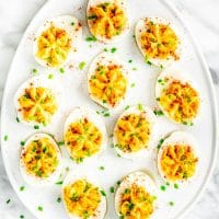 overhead shot of an egg shaped plate covered in deviled eggs