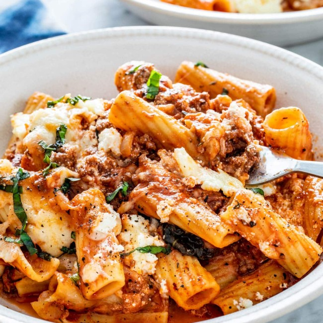 side view shot of baked ziti in a bowl