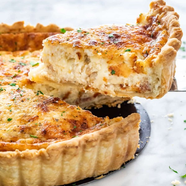 side view shot of a slice of quiche being lifted from the quiche lorraine