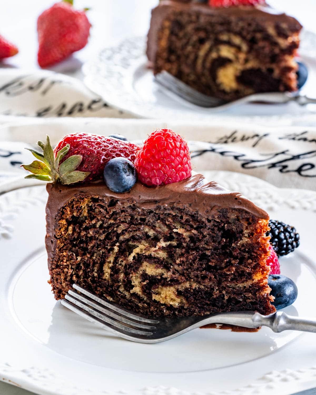 slice of zebra cake on a white plate