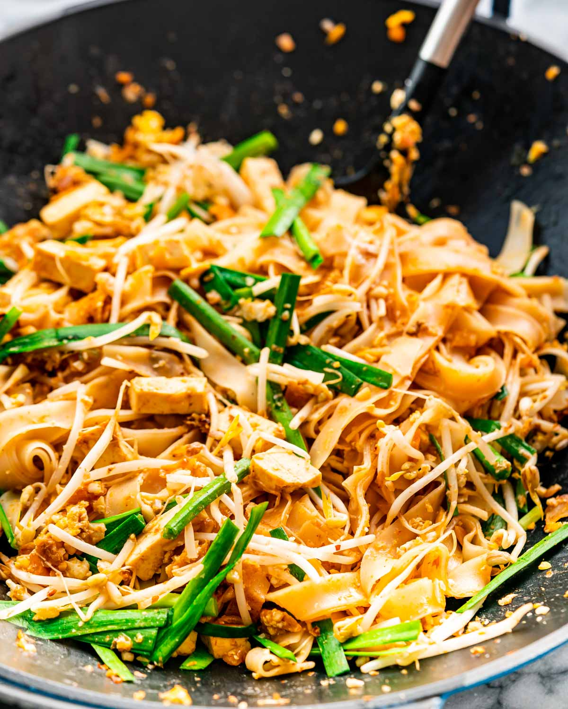 freshly made pad thai in a wok.