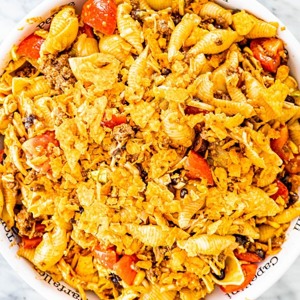 overhead shot of taco pasta salad in a large serving bowl