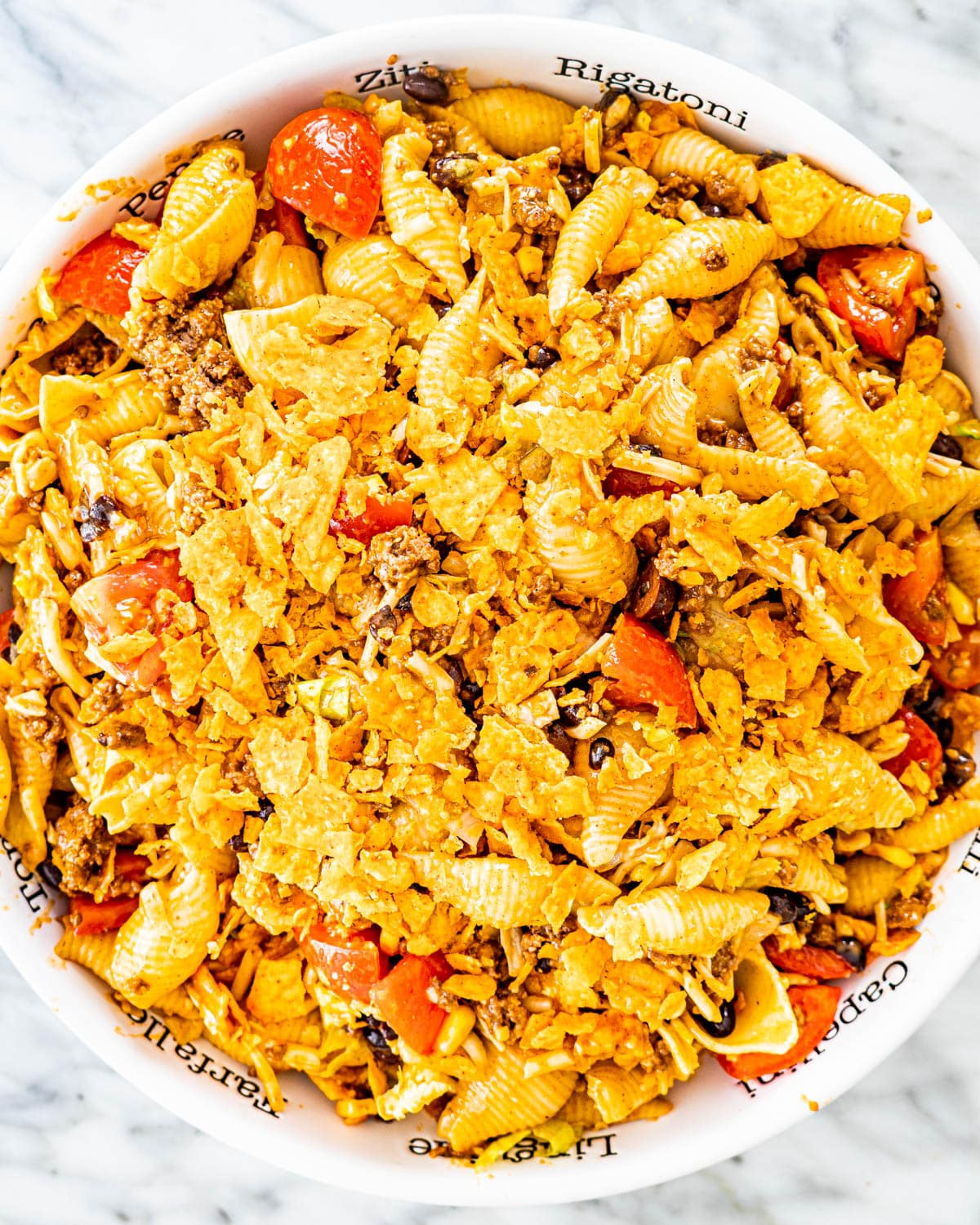overhead shot of taco pasta salad in a large bowl