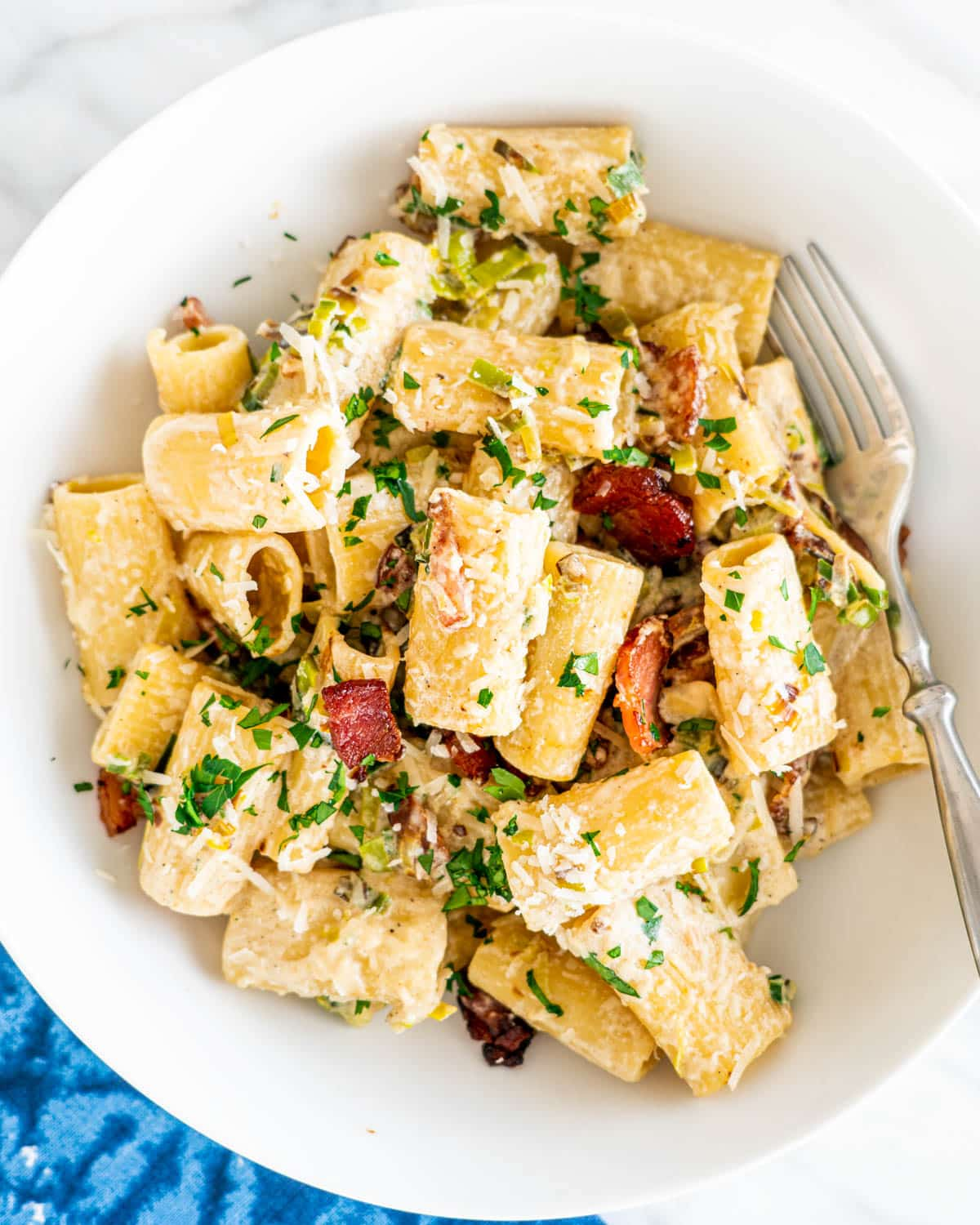 overhead shot of a bowl loaded with rigatoni and bacon