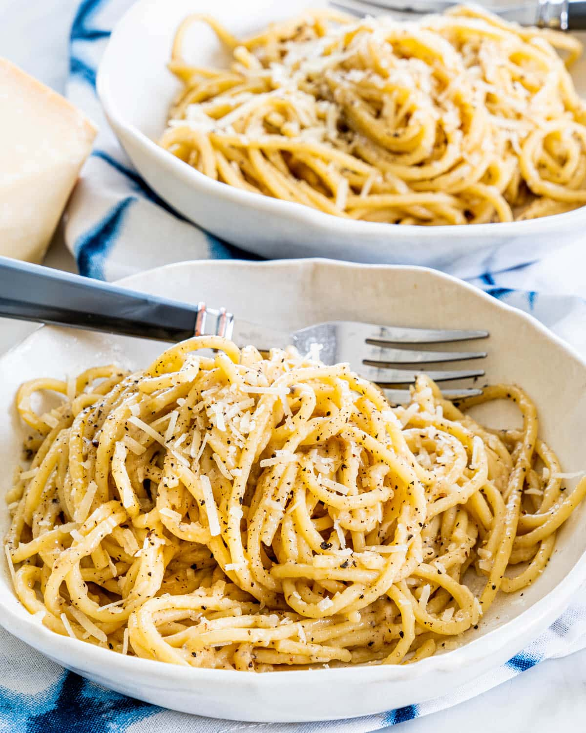 two plates filled with Cacio e Pepe