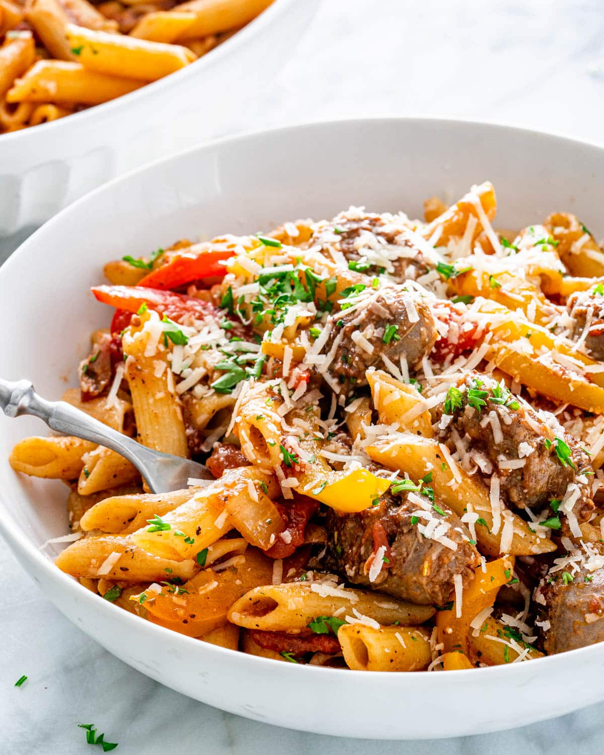 Sausage Pepper Pasta in a white pasta bowl