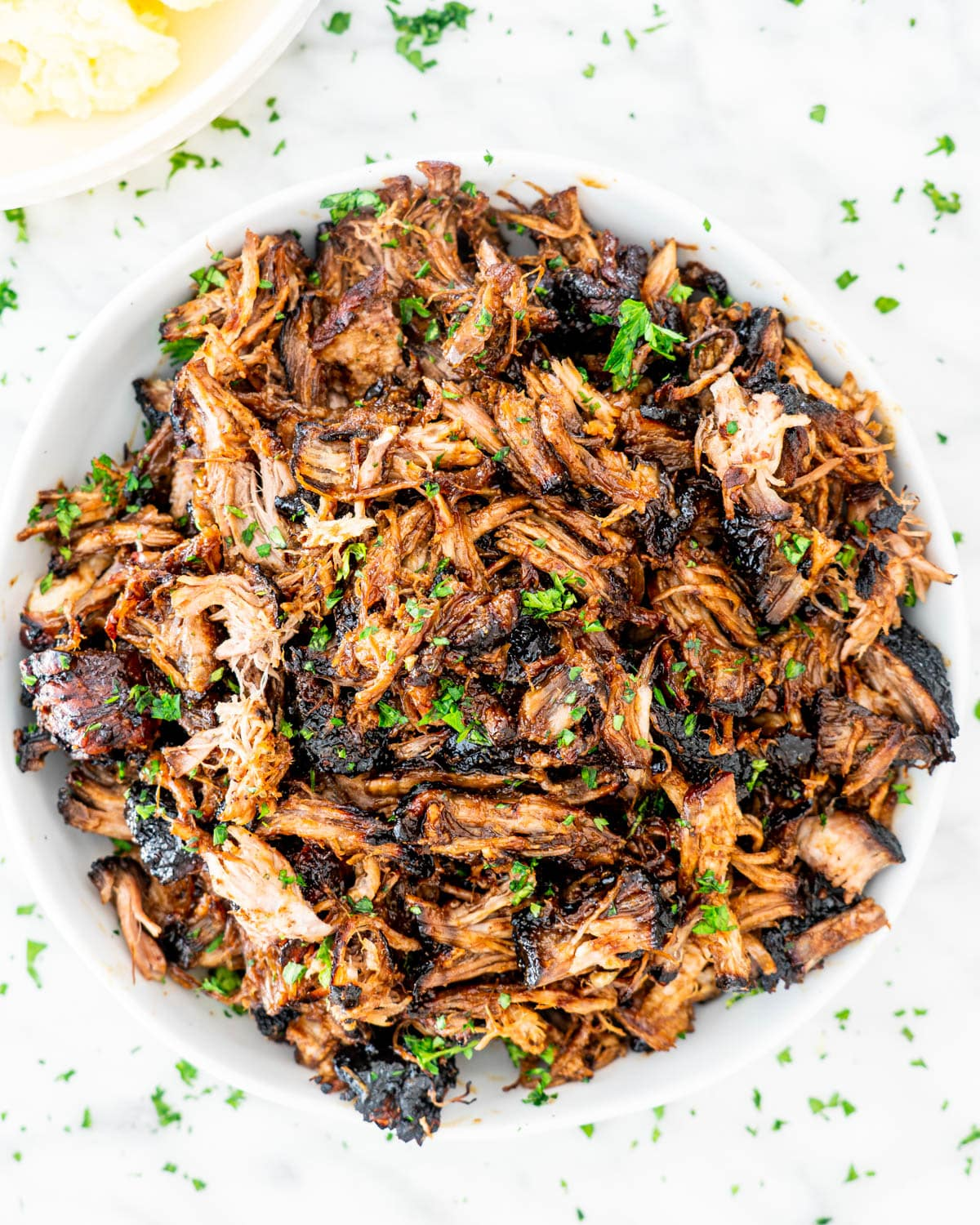 Brown Sugar Balsamic Pulled Pork in a white bowl
