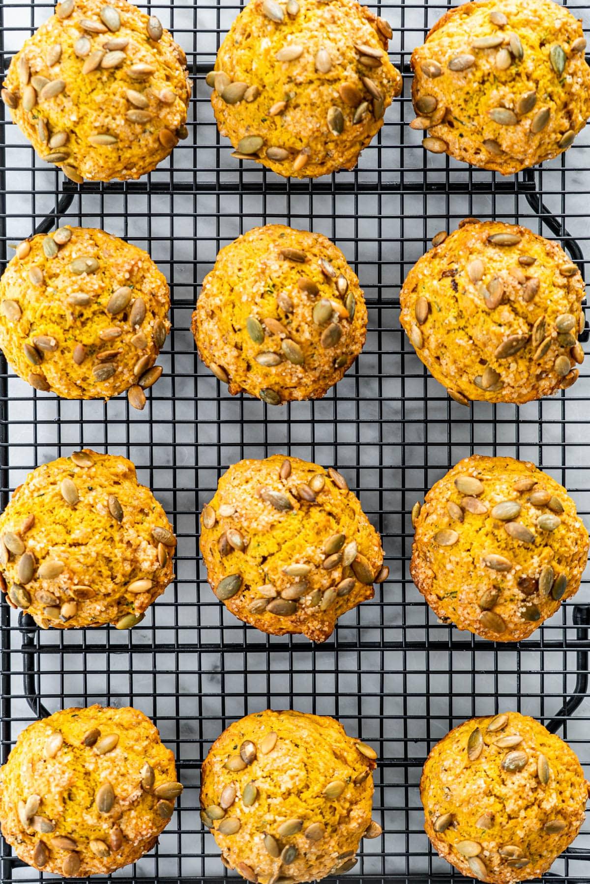 a dozen Pumpkin Zucchini Muffins on a cooling rack