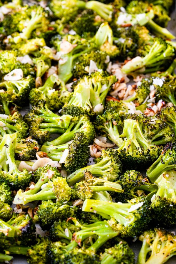 closeup of roasted broccoli on a baking sheet.