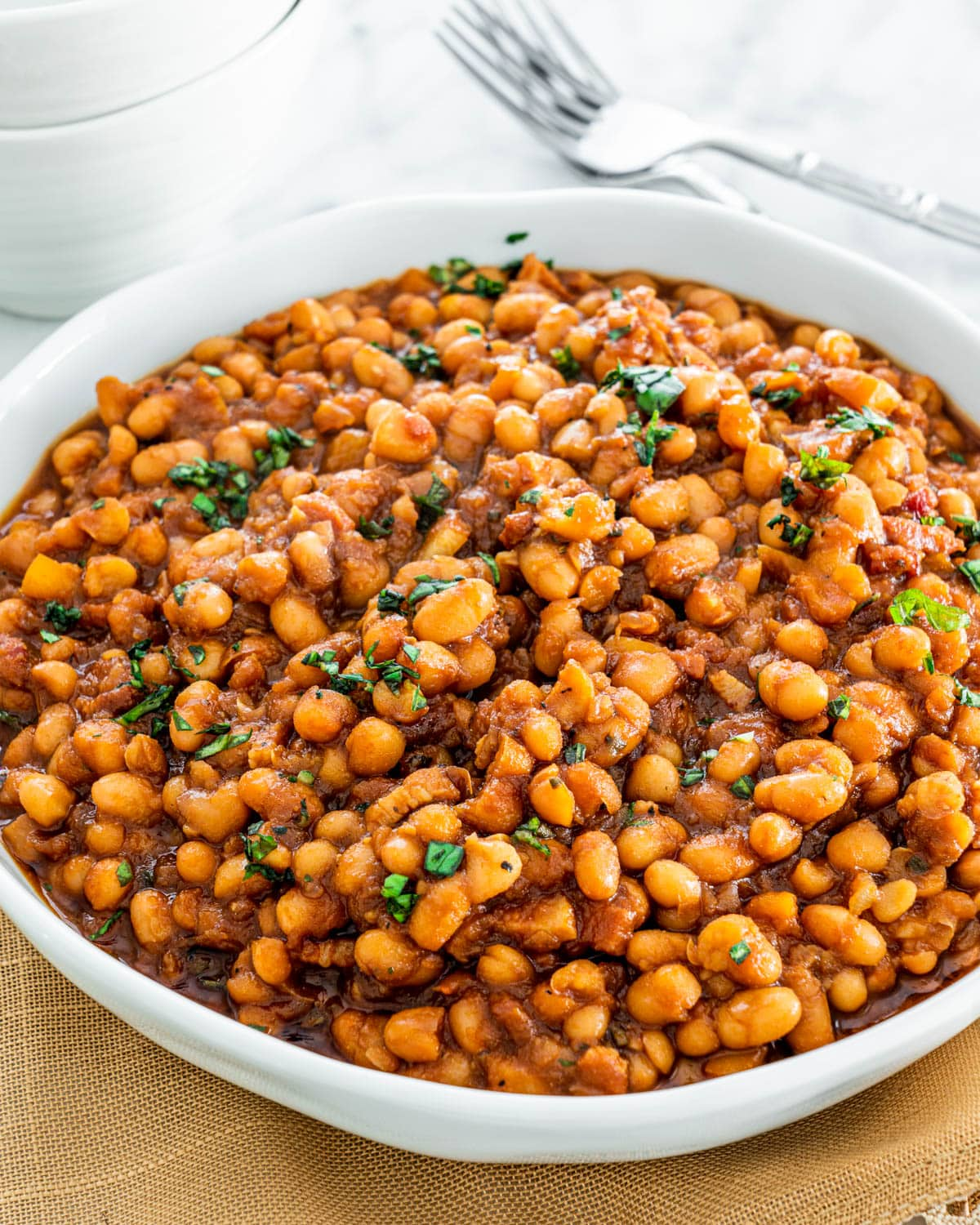instant pot baked beans in a white bowl