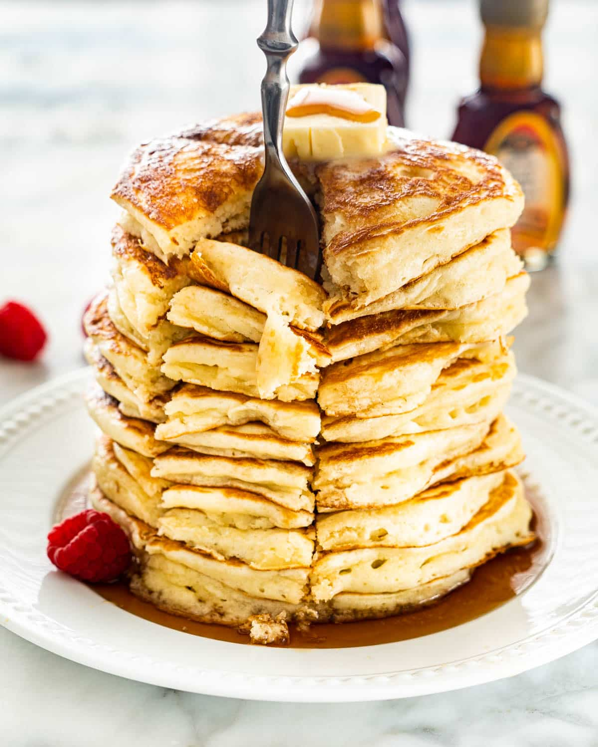 inserting a fork into a stack of pancakes