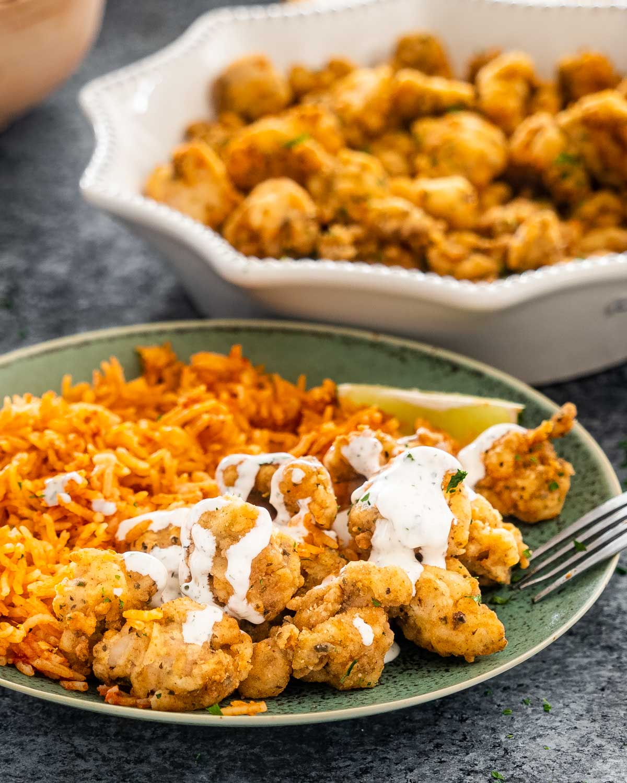 chicharrones de pollo on a plate with mexican rice.