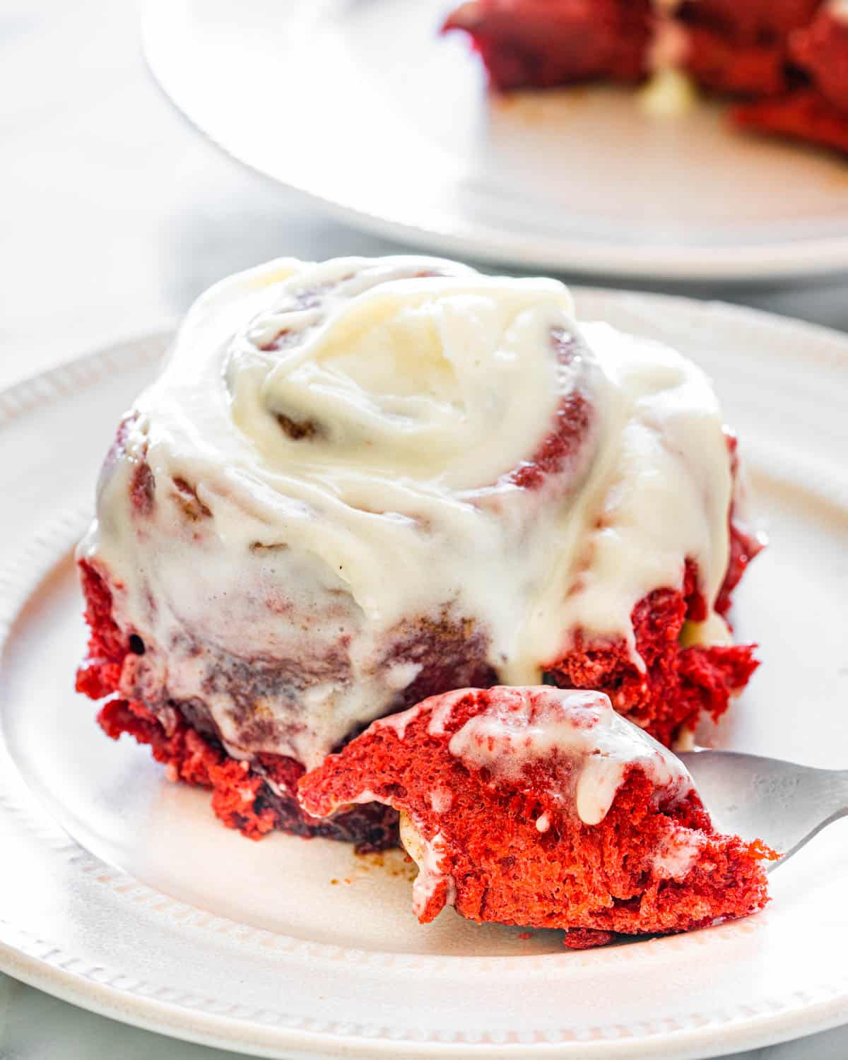 a red velvet cinnamon roll on a white plate