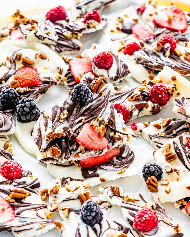 berry and chocolate yogurt bark broken into pieces