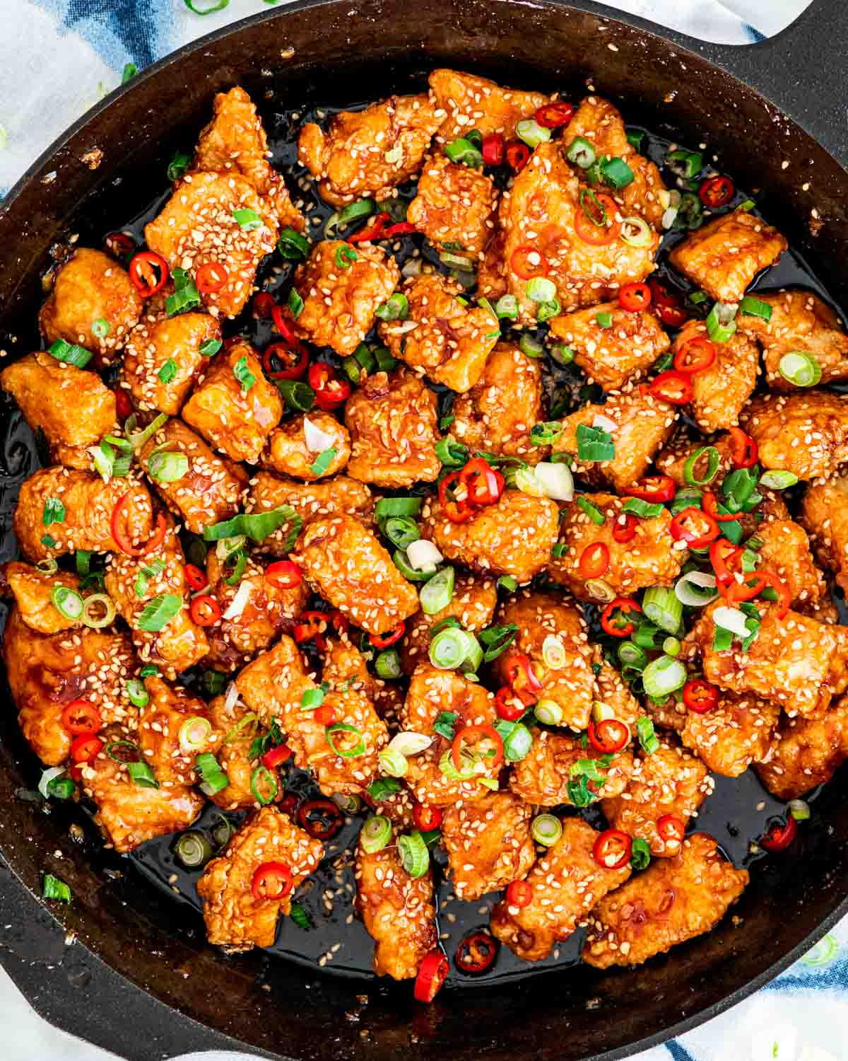 overhead shot of korean fried chicken in a black skillet