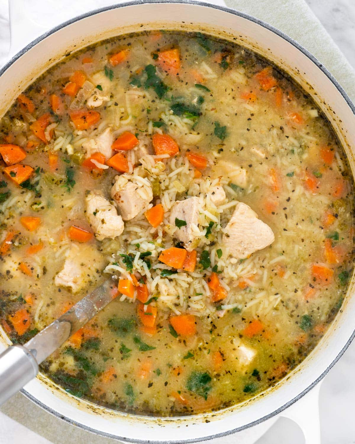 overhead shot of chicken and rice soup in a large dutch oven