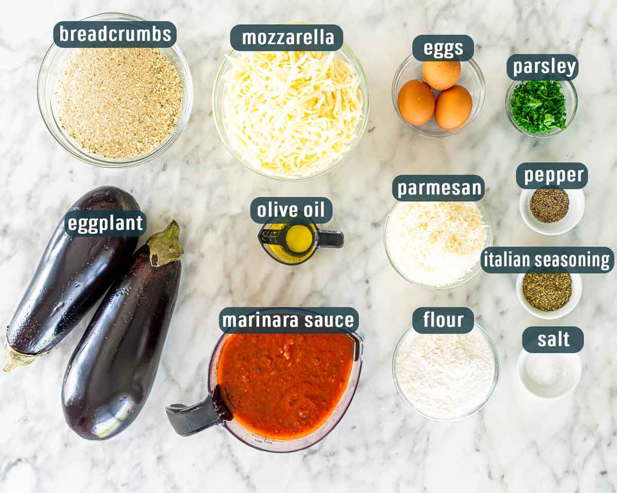 overhead shot of all the ingredients needed to make eggplant parmesan