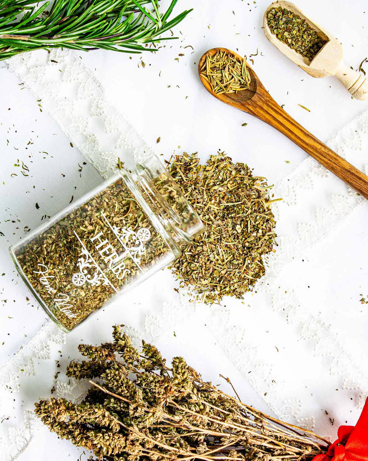 overhead shot of an herb jar on its side spilling italian seasoning on a table