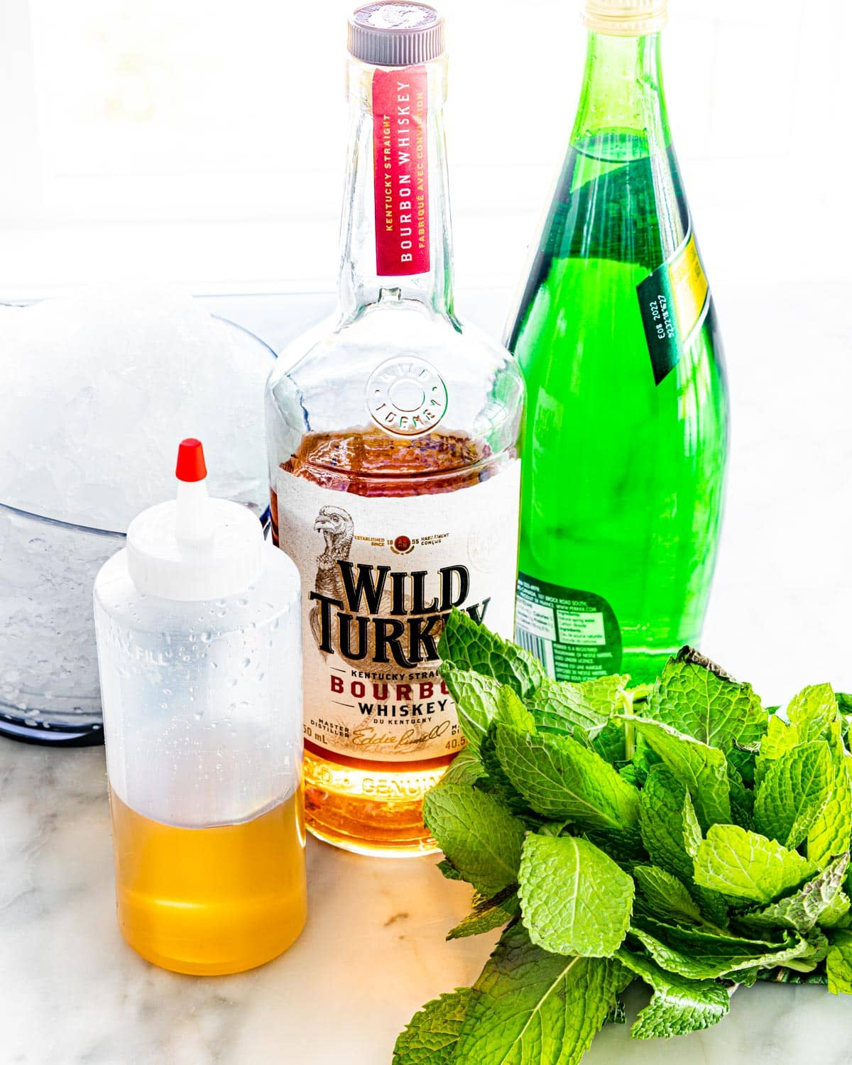 side shot of all the ingredients needed to make a mint julep
