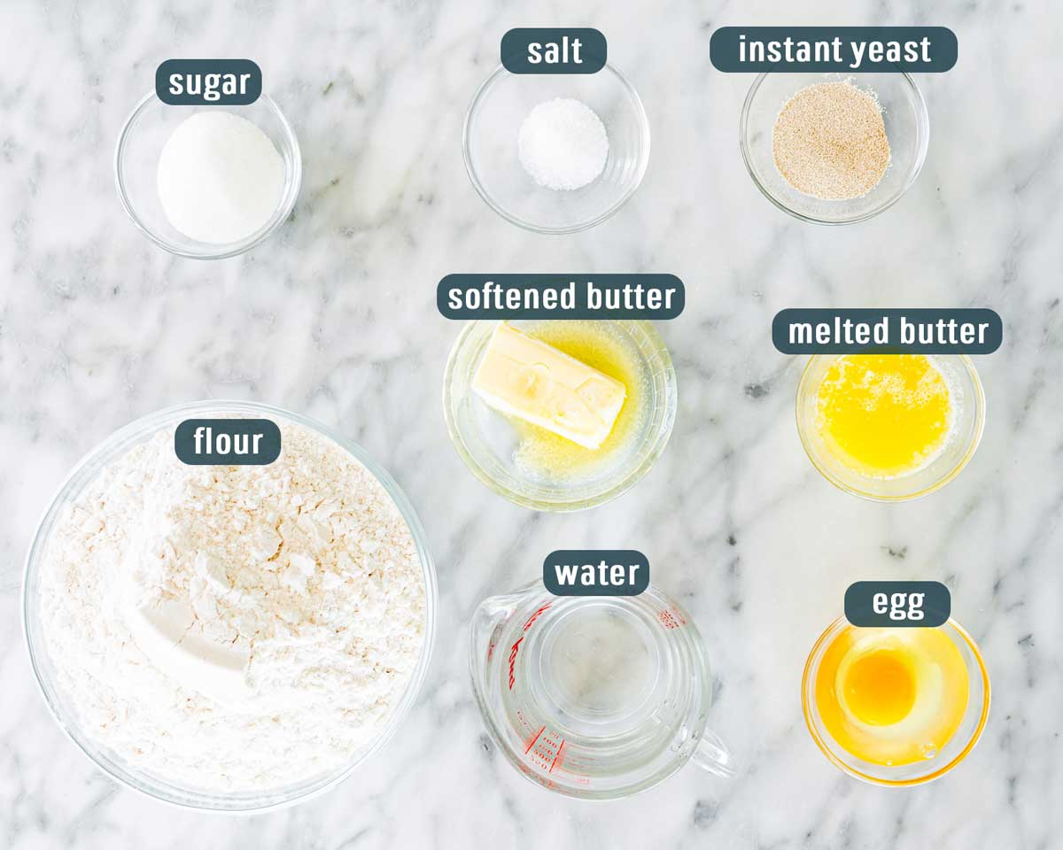overhead shot of all the ingredients needed to make quick dinner rolls