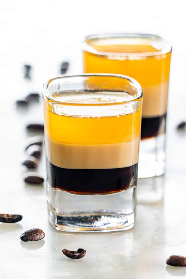 side view shot of b52 shot glasses with coffee beans around