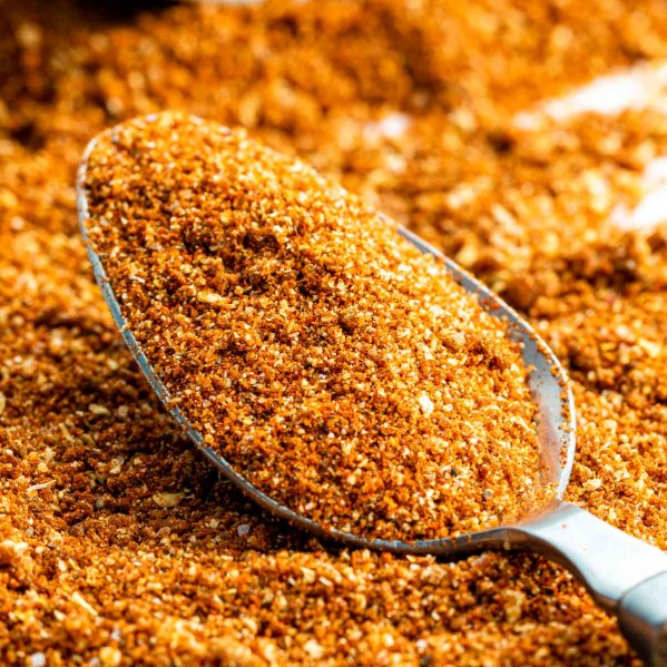 closeup sideview shot of a tablespoon with bbq dry rub surround by it