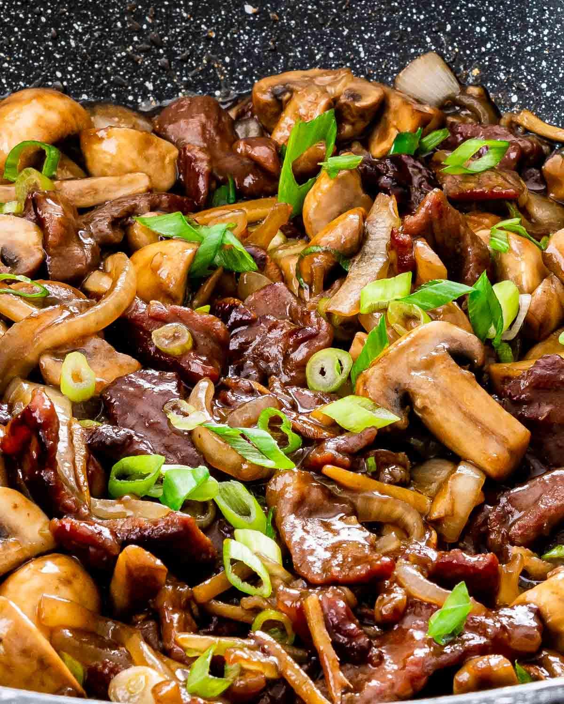 beef mushroom stir fry in a wok