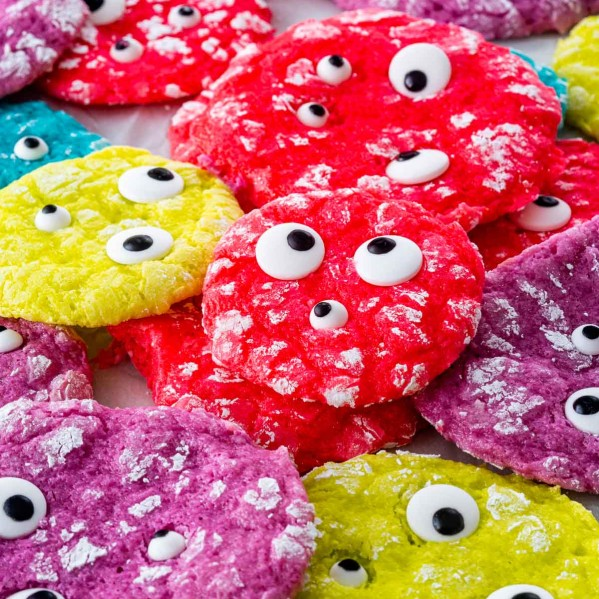 freshly baked monster cookies of all different neon colors with eyeball candy.