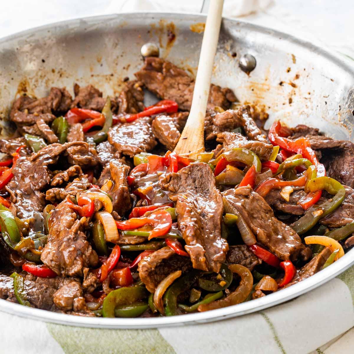 freshly made pepper steak in a skillet
