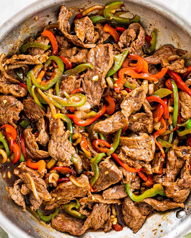 overhead shot of pepper steak in a skillet