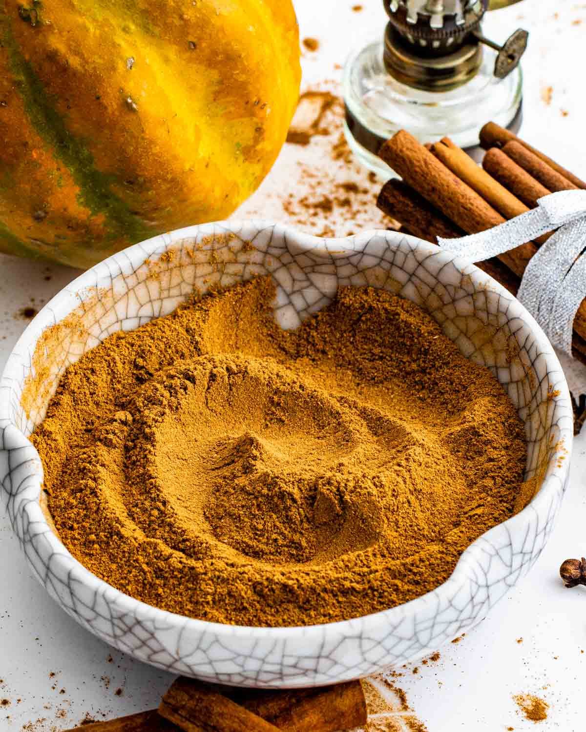 a white bowl with freshly made pumpkin pie spice.