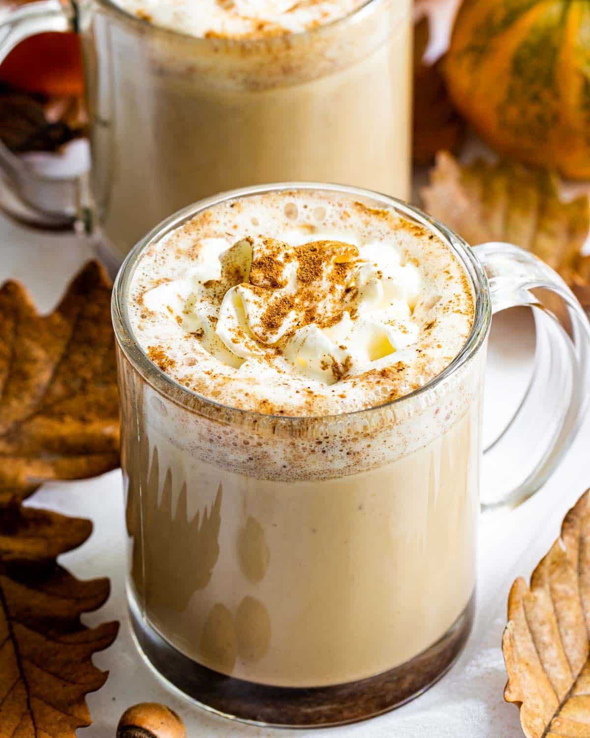 pumpkin pie spice latte in a glass cup.