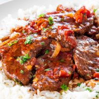 swiss steak over a bed of rice.